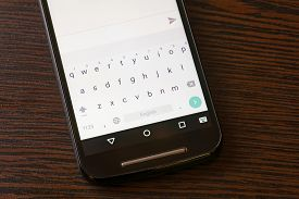 stock photo of qwerty  - A luminous smartphone keypad with qwerty text map - JPG