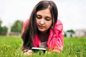 image of sms  - Beautiful girl in the summer in the park - JPG