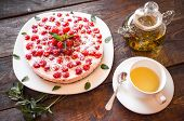 image of teapot  - Appetizing vegetarian pie from protein jelly with fresh berries of raspberry and mint a teapot and a cup with green tea - JPG