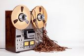 stock photo of messy  - Open Reel Tape Deck Recorder Player with Messy Entangled Tape - JPG
