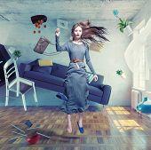 stock photo of zero  - young beautiful lady fly in zero gravity room - JPG