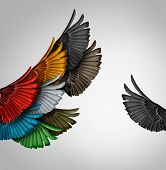 stock photo of thinker  - Go it alone concept and Independent thinker idea or new leadership concept and individuality as a group of united flying bird wings with one individual wing going independent as a business icon for innovative thinking or entrepreneur spirit - JPG