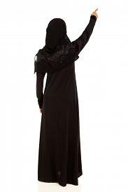 pic of muslim  - rear view of muslim woman pointing empty space - JPG