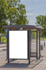 stock photo of bus-shelter  - An image of a bus stop with a blank bilboard for your advertising situated in the swedish city of Angelholm - JPG