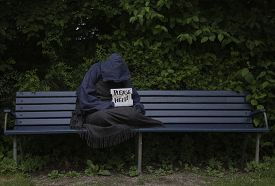 pic of scourge  - Homeless man begging on a park bench - JPG