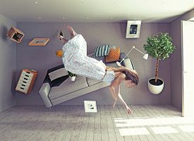 image of zero  - young beautiful lady fly in zero gravity room - JPG