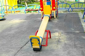 picture of seesaw  - Empty seesaw on playground in public park - JPG