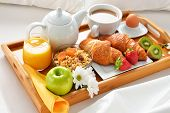 Breakfast Tray In Bed In Hotel Room poster