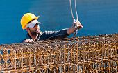 Construction Worker Loading Reinforcement Beam Cages To Crane