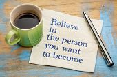 Believe in the person you want to become- handwriting on a napkin with a cup of espresso coffee poster