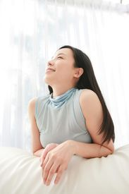 image of japanese woman  - Young Woman at Home - JPG