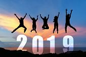Silhouette Happy Business Teamwork Jumping Congratulation Graduation In Happy New Year 2019. Freedom poster