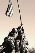 stock photo of iwo  - A statue of the men on Iwo Jima holding up the flag - JPG
