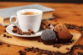 Coffee Break A Cup Of Hot Coffee And Cakes On A Wooden Table With A Book. A White Cup Of Black Coffe poster