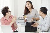 Group Of Young Asian Coworkers Gathering In Office Having Coffee Break While Chilling poster