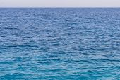 Blue Sea Background. Beautiful Sky And Blue Ocean Or Sea. Blue Sea Surface With Waves poster