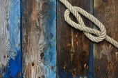 Nautical Rope Knot On A Weathered Wooden Deck poster