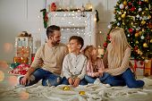 Happy Family Having Fun At Home, Christmas Family Portrait In Front Of The Christmas Tree poster