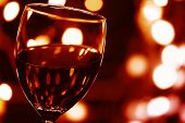 foto of red wine  - Close up on Glass of Red Wine with Lights Background - JPG