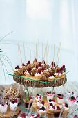 Delicious Sweets On Candy Buffet. Lot Of Colorful Desserts With Strawberry, Raspberry And Blackberry poster