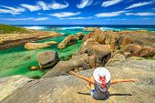 Happy Woman Looking The Huge Cracked Elephant-shaped Oval Rocks Of Elephant Rocks From Promontory. G poster
