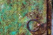 Round Iron Brown Door Knob On The Green Shabby Wall poster