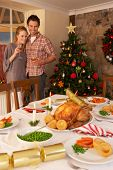 stock photo of christmas dinner  - Young couple at home at Christmas - JPG