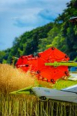 Combine Harvester On A Grain Field During A Hot Harvest. Tractor And Harvester At Harvest Time. The  poster