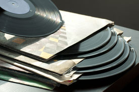 pic of lps  - LPs and covers.Natural light. Horizontal image . ** Note: Shallow depth of field - JPG