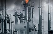 oil, gas and fuel installation, burning safety flames in middle tower, blue toning concept