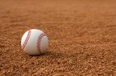 stock photo of infield  - Baseball on the Infield Dirt with room for copy - JPG
