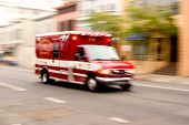 stock photo of fire truck  - a fire rescue vehicle blazes by - JPG