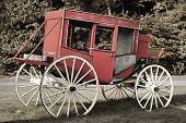 picture of stagecoach  - An old western stagecoach sits in the grass - JPG