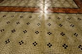 stock photo of neo-classic  - Neo Classical floor tiles and shadow of wrought iron grille - JPG