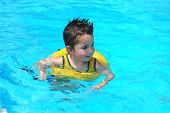 picture of swimming pool family  - little boy in family pool - JPG