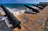 stock photo of cannon  - Cannons overlooking from Cape Coast Castle - JPG
