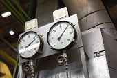 pic of vacuum pump  - White, rusty industrial measurement device closeup photo