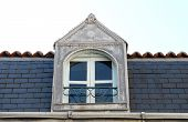 stock photo of poitiers  - Old dormer window on a 19th century townhouse in Poitiers France - JPG