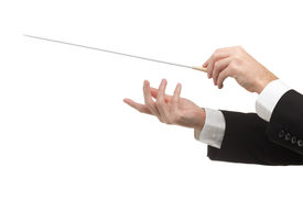 foto of nonverbal  - Male orchestra conductor hands one with baton - JPG