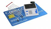 foto of over counter  - one cash register and a shopping cart over a credit card  - JPG