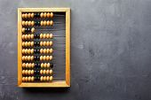 picture of subtraction  - Accounting abacus on gray textured background with copy space - JPG