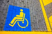 picture of physically handicapped  - detail of the symbols painted on a disabled reserved parking lot - JPG