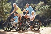 pic of bike path  - Senior couple with grandchildren on country bike ride - JPG