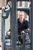 stock photo of forklift driver  - Forklift driver - JPG