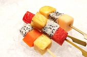 stock photo of fruit platter  - Platter of fruit skewers with a dish Healthy party food - JPG