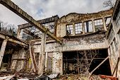 picture of collapse  - old abandoned and collapsed factory with rubble and debris - ruins of an ancient industrial building - hdr image