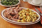 stock photo of pot roast  - Succulent turkey pot roast with corn bread stuffing and kale salad - JPG