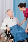 stock photo of hospice  - Nurse helping disabled man in a hospice - JPG