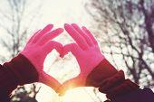 stock photo of instagram  - Heart symbol at sunset - JPG