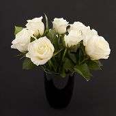 picture of funeral  - Vase white roses for a funeral isolated on black - JPG